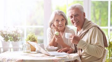 Feature | Beautiful elderly couple having breakfast | Best Custom Giveaways Ideas for Senior Citizens Day